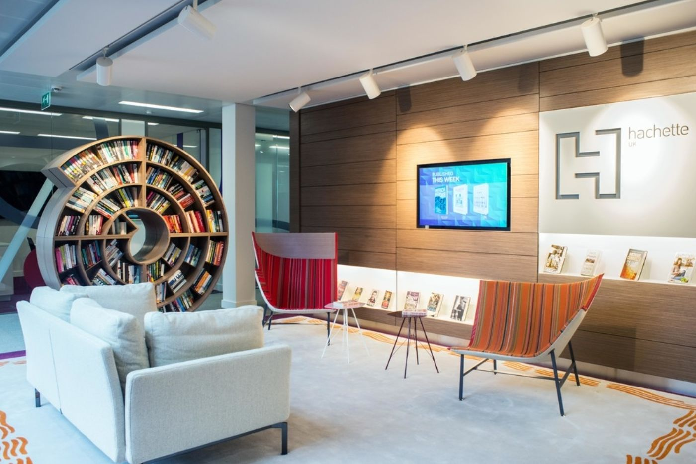 Cool chairs and circular book case in this funky office fit out