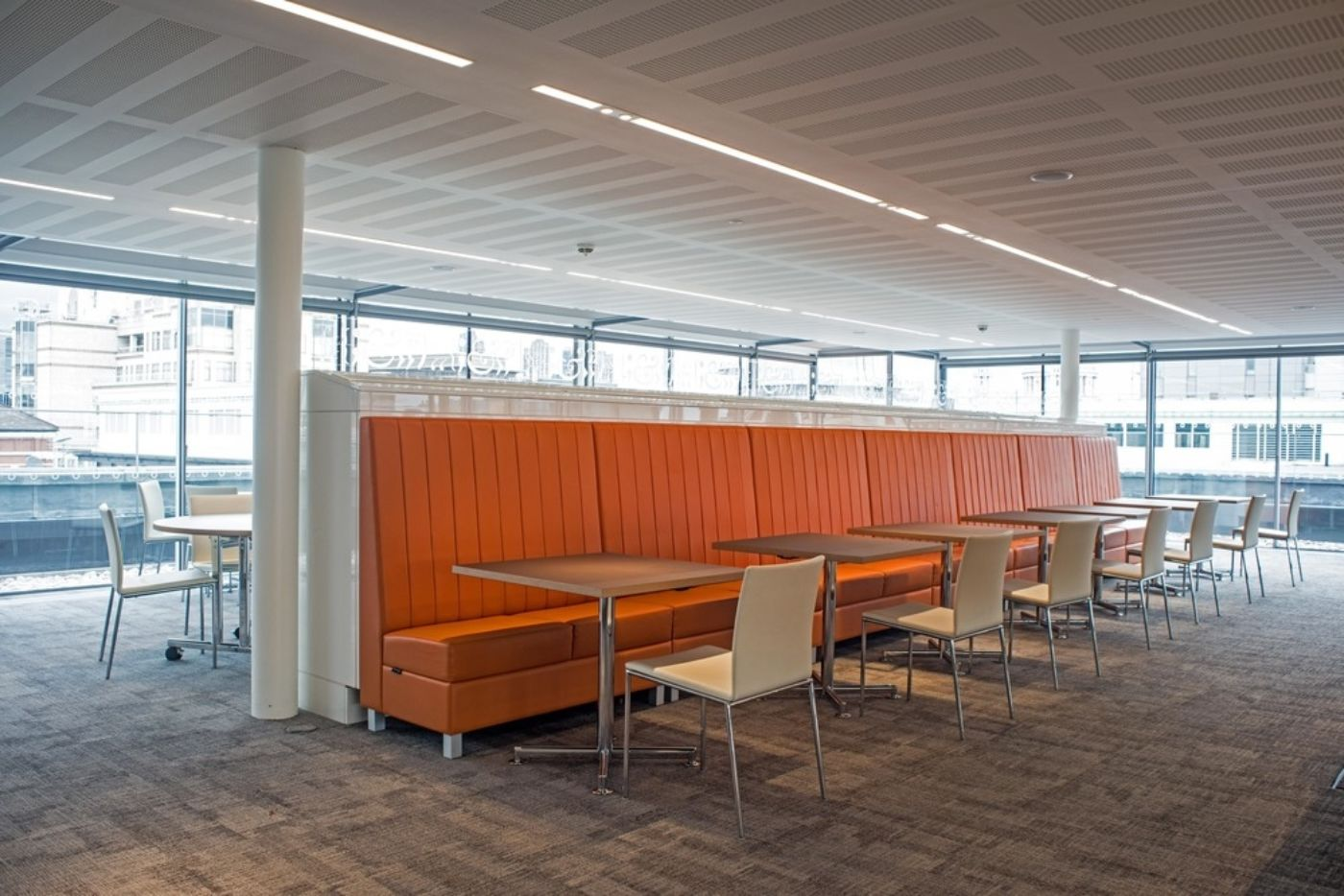 Bright and colourful seating in office dining area