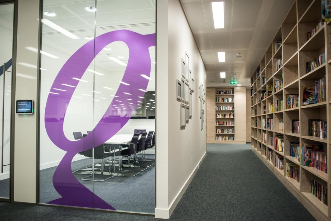 Meeting room and hallways with floor-to-ceiling bookshelves