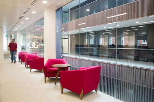 Informal seating with pink armchairs in modern office fit out