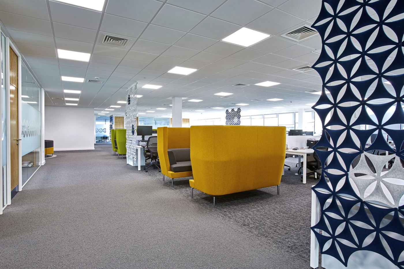 Vibrant meeting areas situated between meeting rooms and workstations