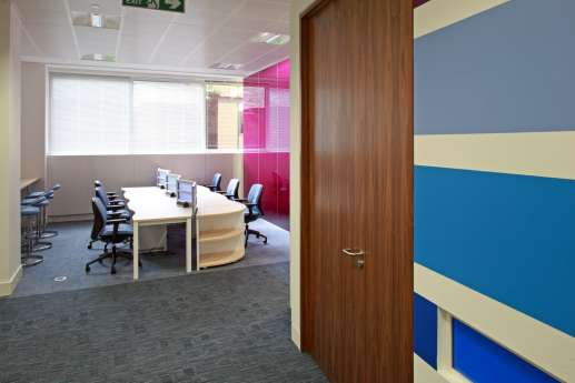 Staff seating area with colourfal walls