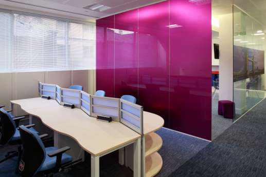 Staff seating area with bright pink screen