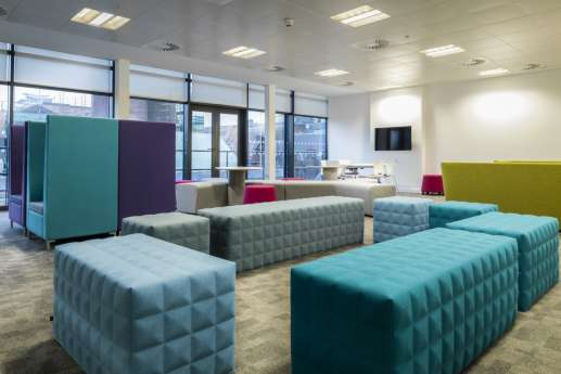 Colourful stools in informal meeting area