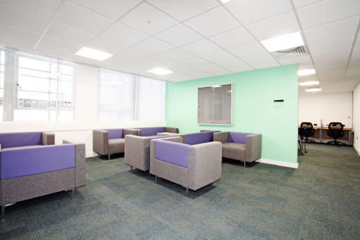 Colourful sofas in office fit out