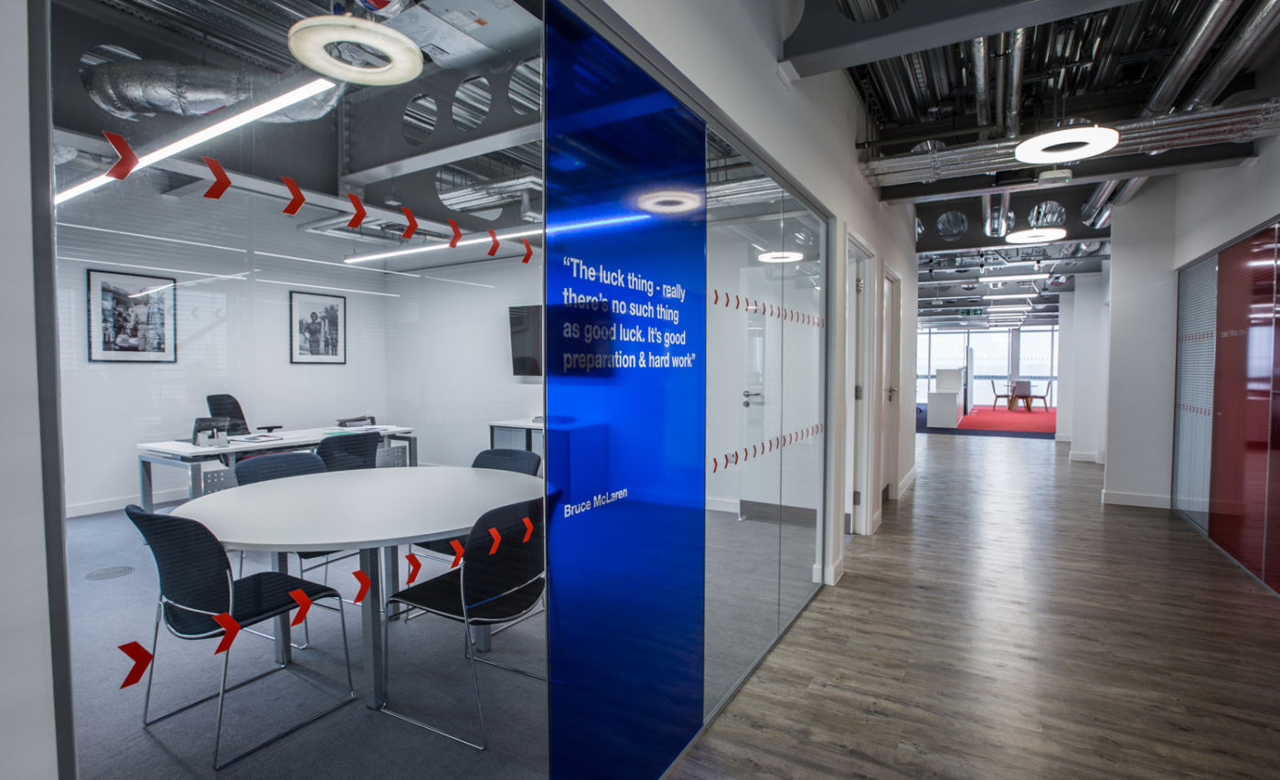 Meeting room with coloured glass panels in modern office fit out for Land Rover