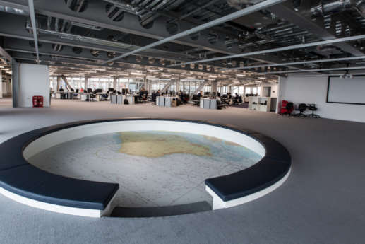 Sunken circular seating area with a map on the floor in Land Rover's Office Fit Out