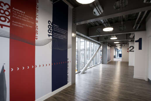 Hallway with wooden floors and open ceiling facilities in office fit out