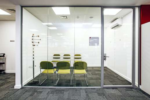 Meeting room behind glass screen