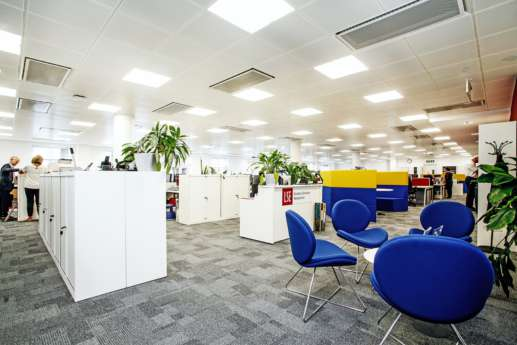 Bright blue seating in reception area
