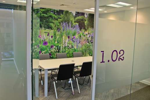 Meeting room with lavender wall print