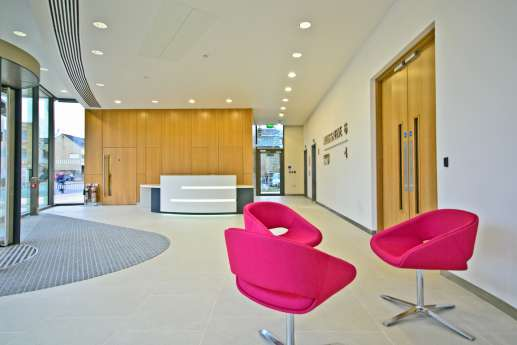 Office reception with pink seats
