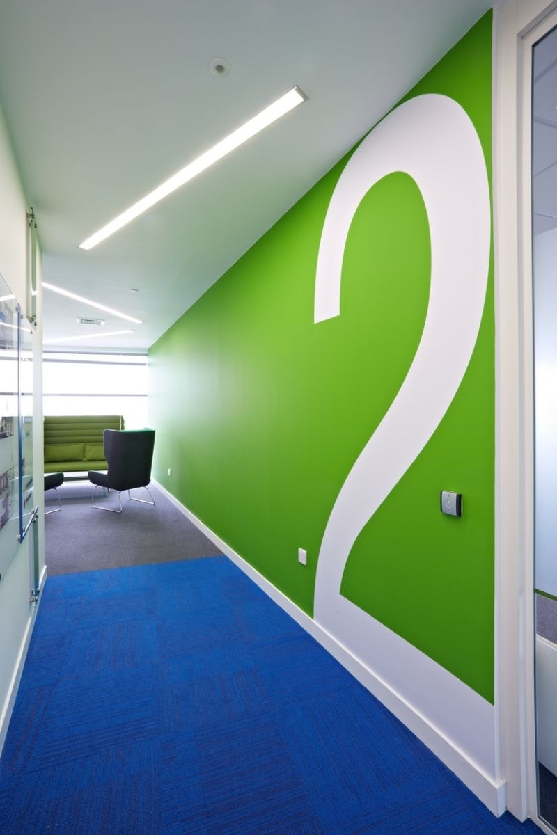 Bright green wall art in seating area
