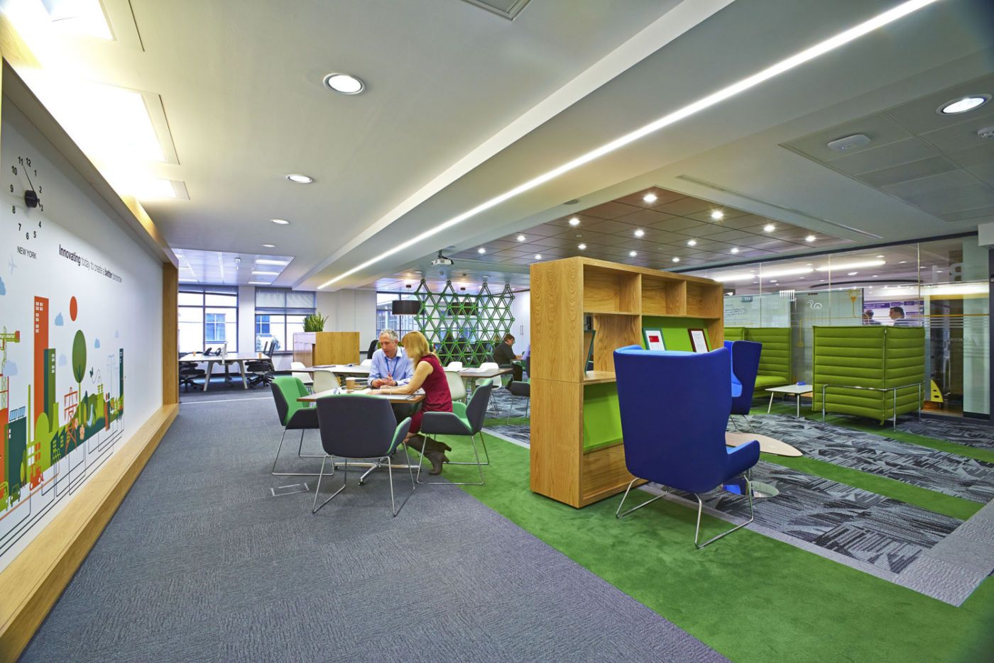 Staff meeting in an open plan seating area