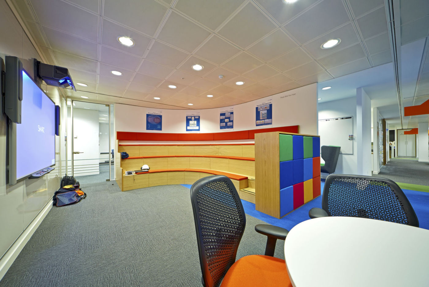 Tiered seating in a colourful office fit out