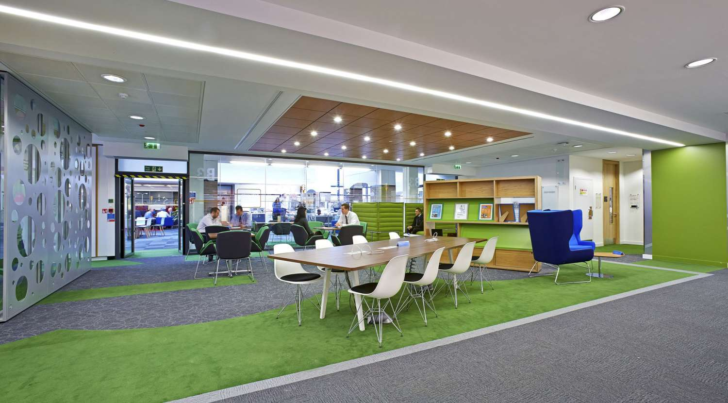 Informal Meeting Area With Green Carpet And Funky Seating