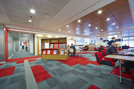 Open plan office layout with red flooring