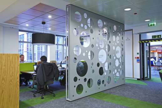 Glass meeting room divided by funky wall detailing