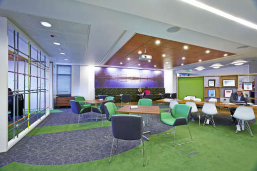 Colourful and open plan seating area in modern office