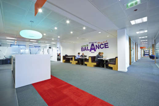 Booth seating with a red stripe in spacious office fit out