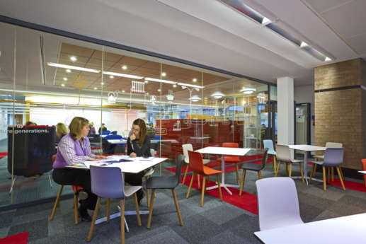 Meeting room with coloured chairs and tables in designer Warwick office fit out