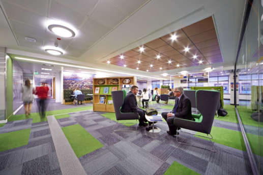 Businessmen having a meeting in an open plan Warwick office
