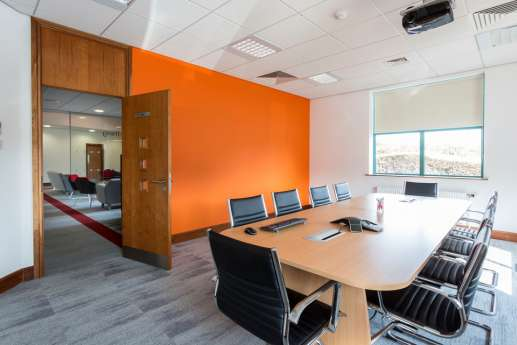Meeting room with bright orange wall