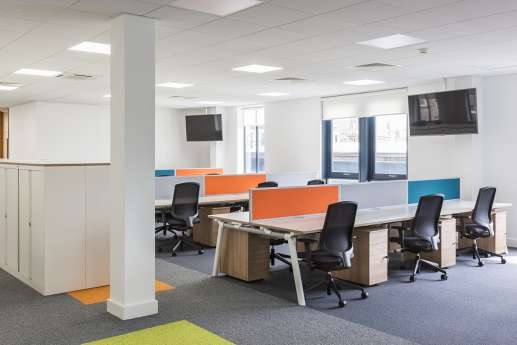 Staff desks in colourful fit out