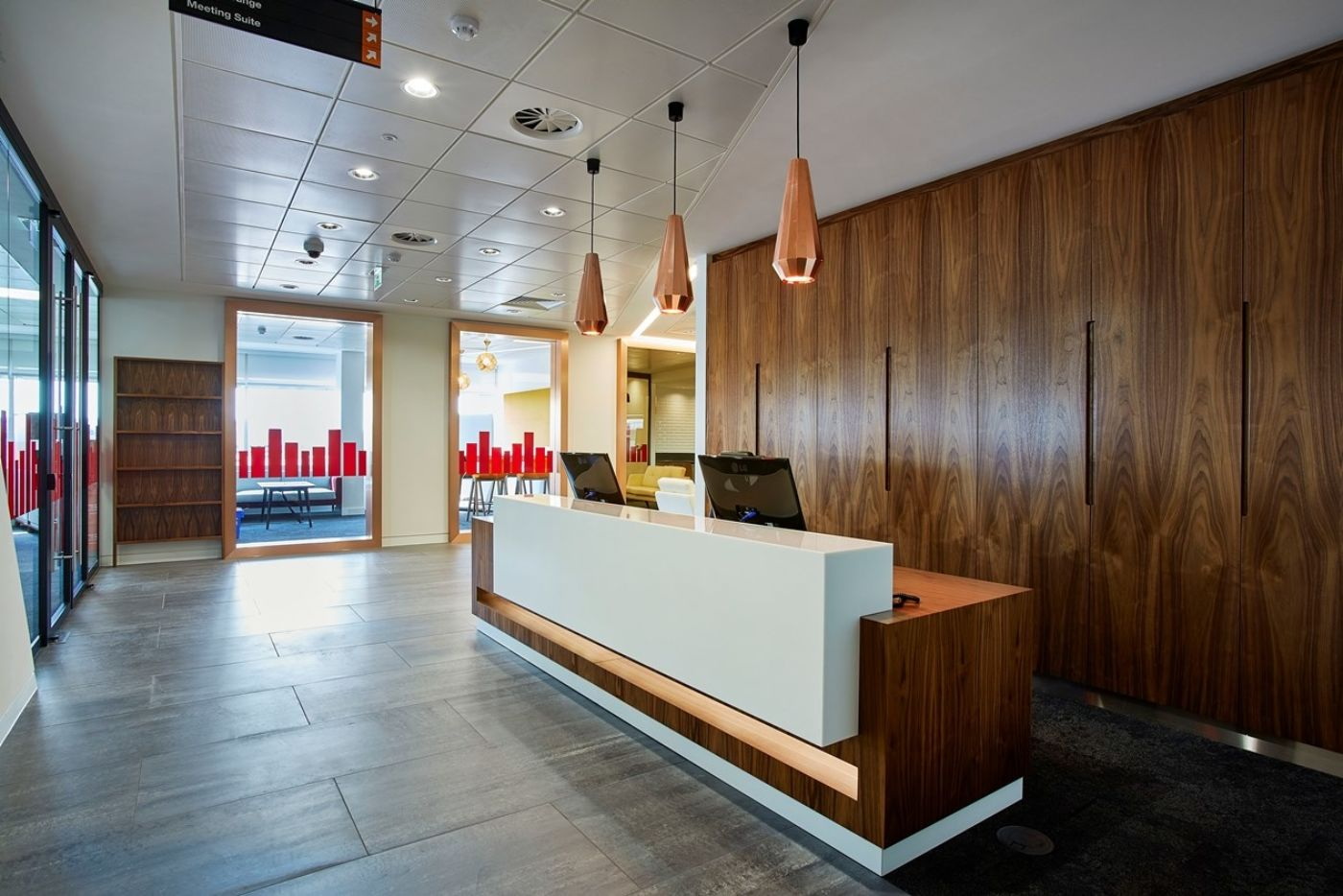 Office reception with wood and chrome finishings in Bristol