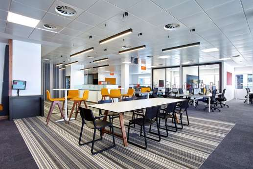 Low and high office chairs in open plan fit out
