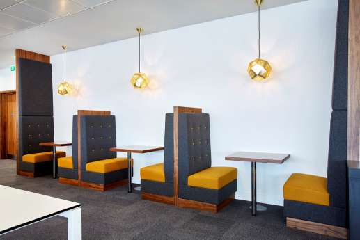 Colourful booth seating in modern office fit out for PwC