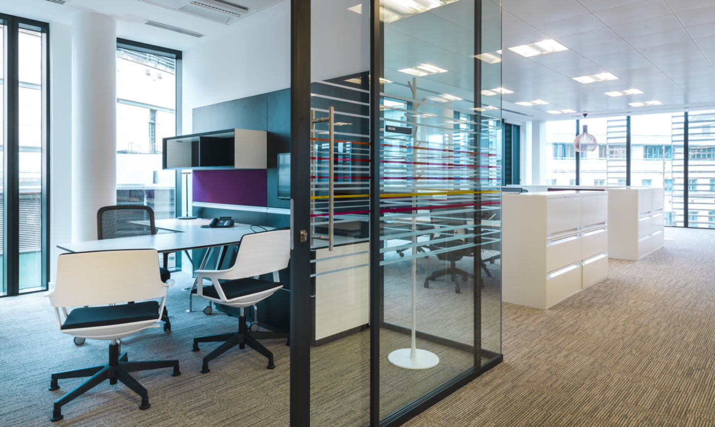 Glass walled offices with modern furnishings