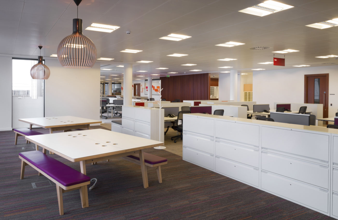 Office fit out with coloured stools and storage solutions
