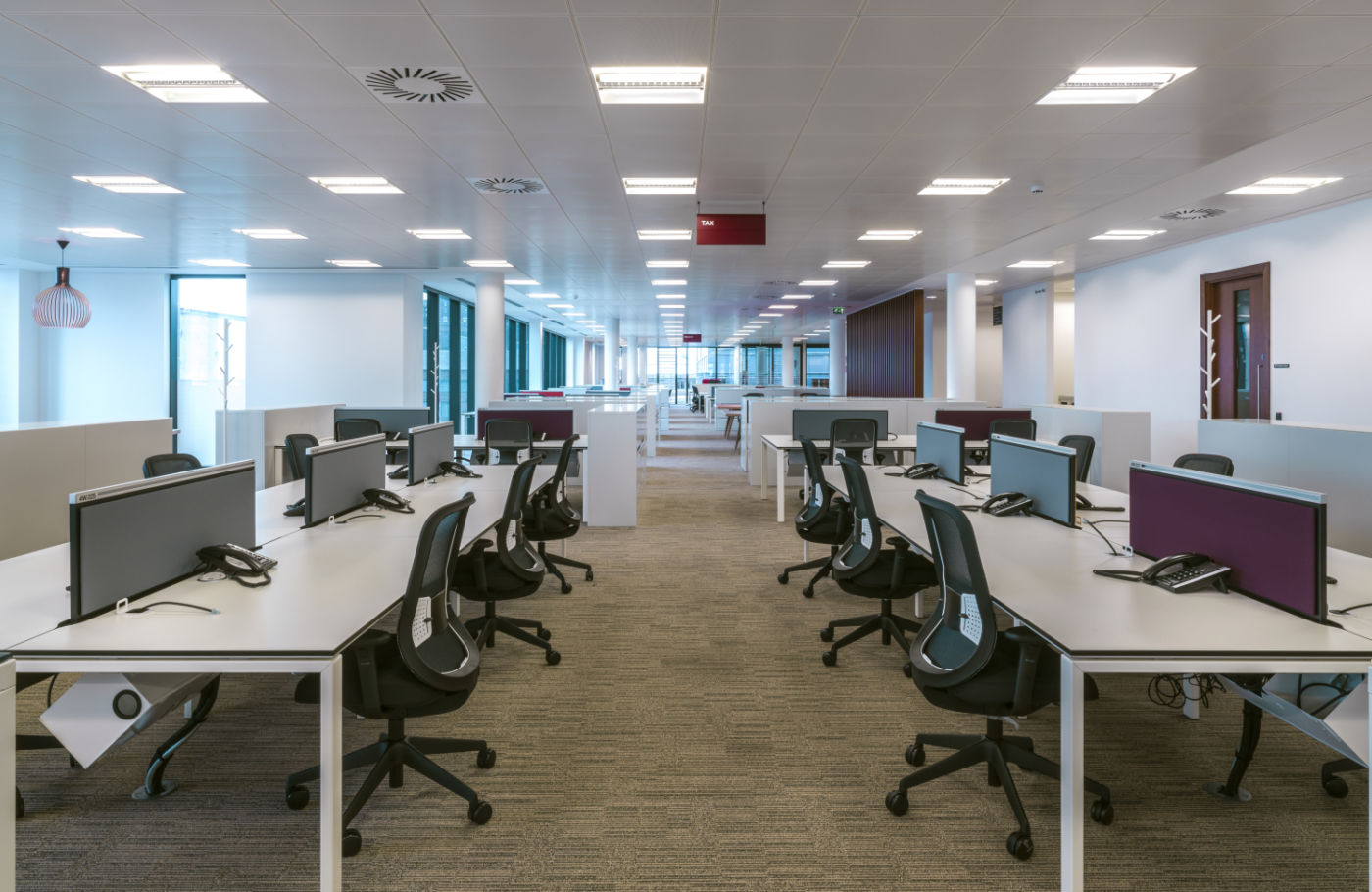 Open plan office with vacant workstations