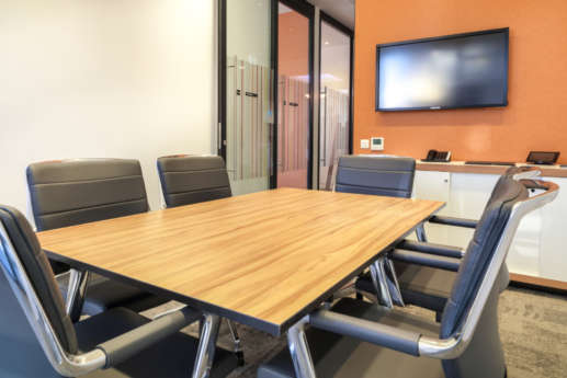 Wooden desk and leather chairs in meeting room