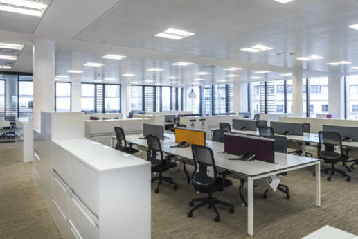 Empty workstations in modern office