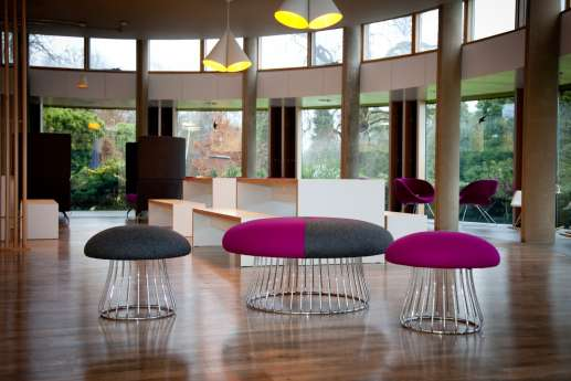 Colourful seating and wooden floors in modern office fit out