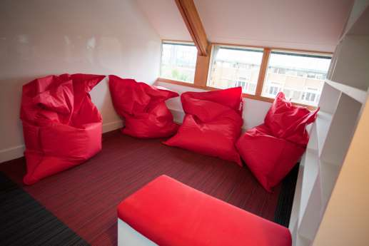 Red bean bags in funky loft fit out