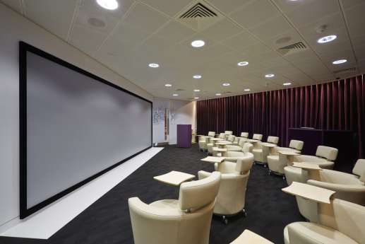 Floor to ceiling screen in seminar room