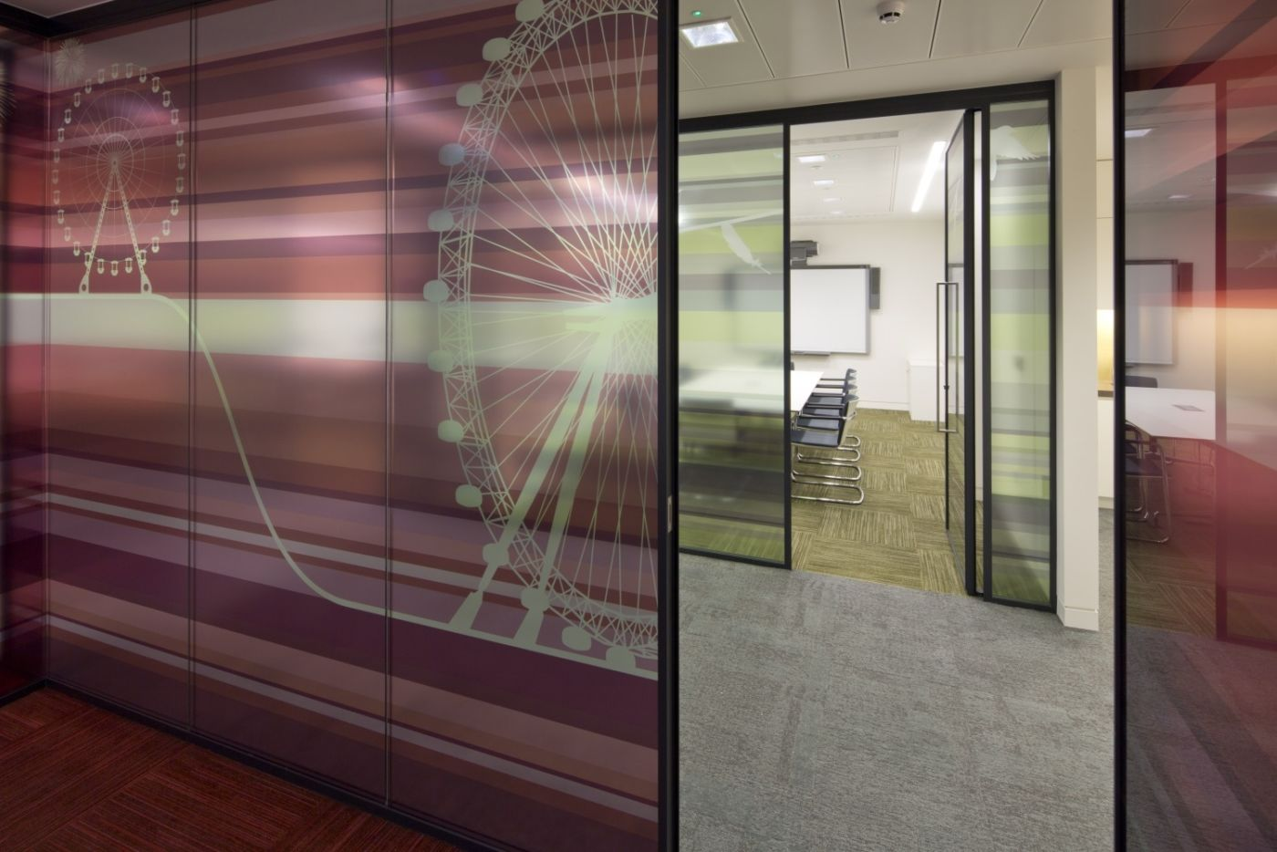 Meeting rooms with glass walls and modern details in London office fit out