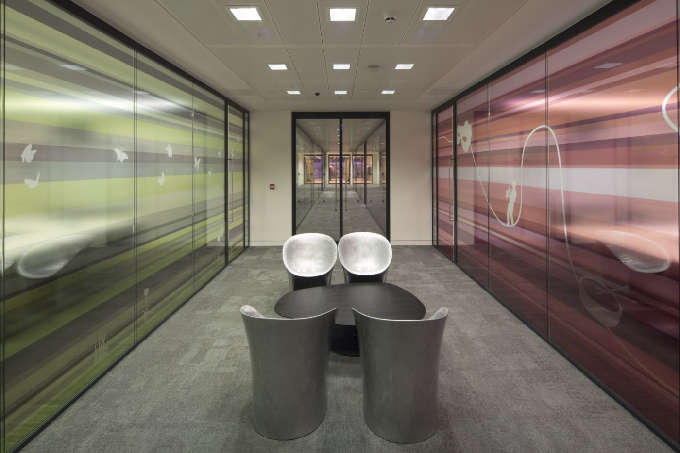 Modern seating in-between two meeting rooms in London office fit out
