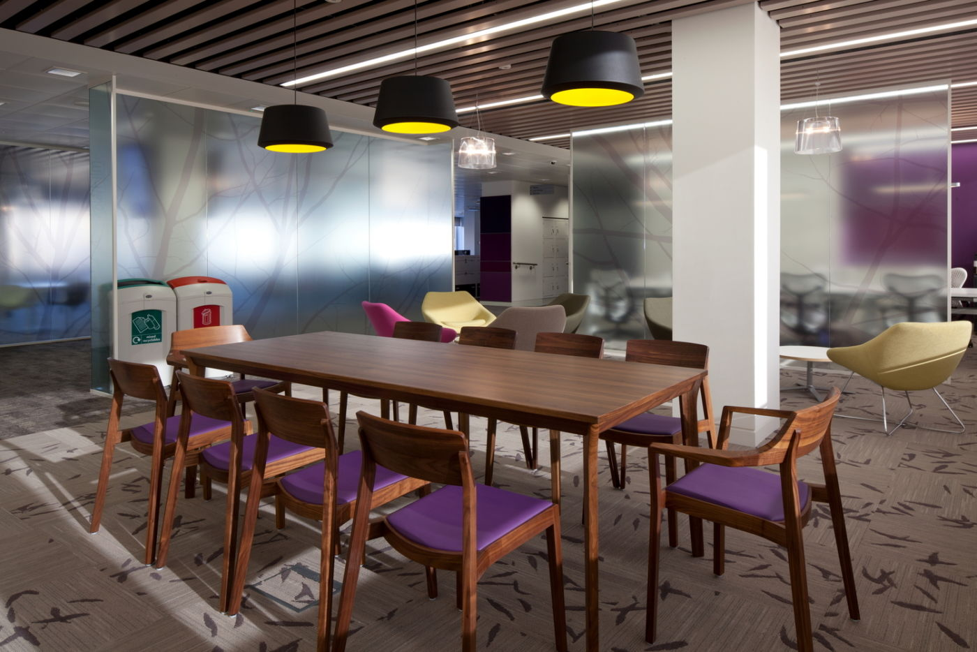 Table in office breakout area with dark wood finishing