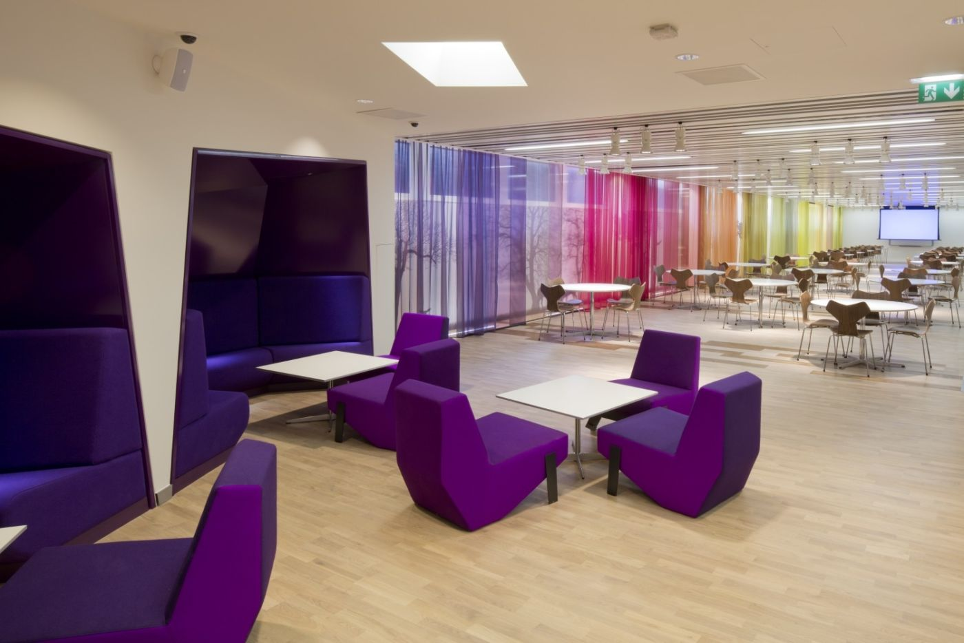 Purple booth and modular seating in relaxed breakout area
