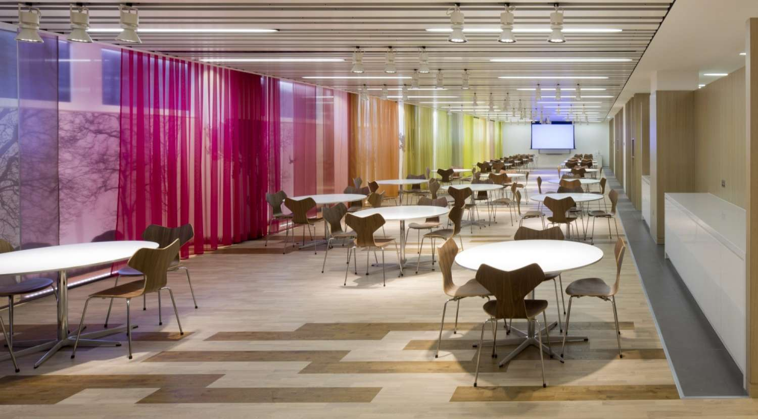 Colourful staff seating area with circular tables