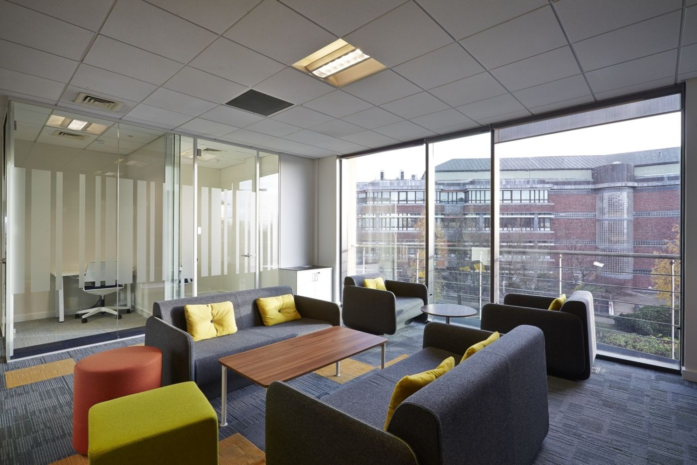 Floor to ceiling windows by informal seating area