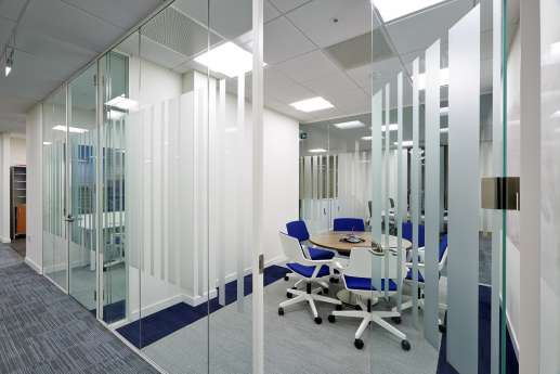 Circular table in glass meeting room