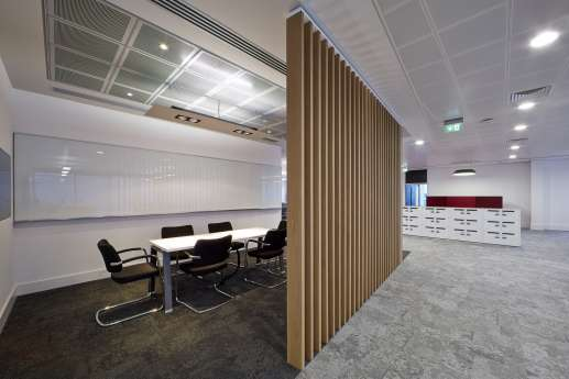 Meeting room behind large wooden screen