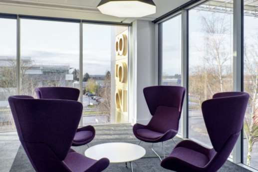 Purple chairs by floor to ceiling windows