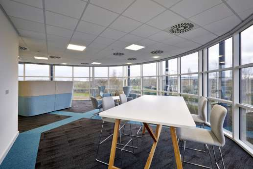 High tables by large office windows