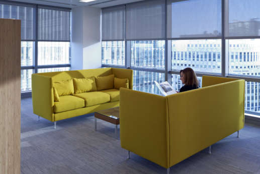 Bright sofas by floor to ceiling windows